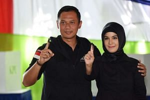 Mr Agus Harimurti Yudhoyono and his wife Annisa Pohan during the election for Jakarta's governor on Feb, 15, 2017.