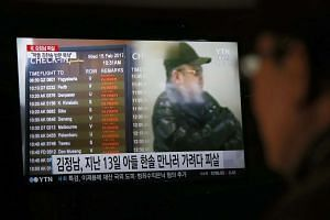 A South Korean watching TV showing breaking news about the alleged assassination of North Korean leader Kim Jong Un's half-brother, in Pyeongchang, Gangwon-do, South Korea, on Feb 15, 2017.