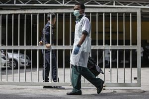 A hospital worker outside a mortuary of the Forensic Department of the Kuala Lumpur General Hospital on Feb 17, 2017.