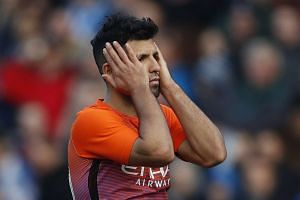 Manchester City's Sergio Aguero looks dejected.