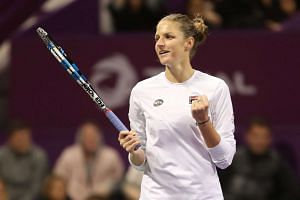 Karolina Pliskova of the Czech Republic reacts after winning against Denmark's Caroline Wozniacki.