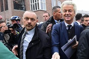 Mr Wilders greeting a supporter in the blue-collar town of Spijkenisse. He has been leading opinion polls ahead of crunch elections on March 15.