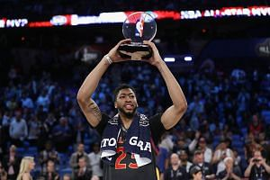 Anthony Davis #23 of the New Orleans Pelicans celebrates with the 2017 NBA All-Star Game MVP trophy after the 2017 NBA All-Star Game at Smoothie King Center on Feb 19, 2017, in New Orleans, Louisiana.