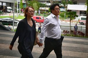 Ong Jenn (right) and his wife arriving at the State Courts, on Feb 20, 2017.
