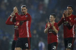 Manchester United's Zlatan Ibrahimovic, Ander Herrera and Chris Smalling applaud fans after the game.