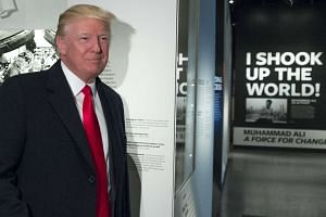 Donald Trump tours the Smithsonian National Museum of African American History and Culture in Washington, Feb 21, 2017.