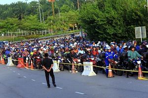 """There have been long motorbike queues at the Bangunan Sultan Iskandar CIQ complex in Johor Baru in the last two days, caused by eight faulty gantries at the automated """"M-Bike"""" lanes."""