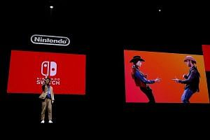 Nintendo Switch general director Kouichi Kawamoto introducing the Switch at its presentation ceremony in Tokyo last month. Retailers in Singapore have listed Nintendo Switch bundles (with up to two games) at $600 to $700, against $425 for the console
