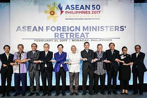 (From left) Laos' Foreign Minister Saleumxay Kommasith, Malaysia's Foreign Minister Anifah Aman, Myanmar's Minister of State for Foreign Affairs U Kyaw Tin, Thailand's Foreign Minister Don Pramudwinai, Vietnam's Foreign Minister Pham Binh Minh, Phili