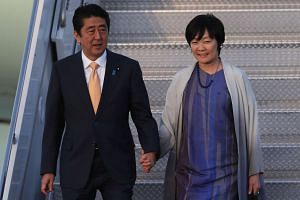 Japanese Prime Minister Shinzo Abe and his wife Akie Abe arrive on Air Force One at the Palm Beach International airport on Feb 10, 2017.