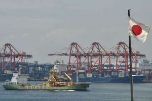 A 2016 file photo shows the Japanese national flag at a cargo terminal area of Tokyo port.