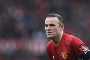 """I am staying at Manchester United,"" Rooney (above) said in a statement."