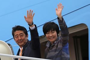 Japanese Prime Minister Shinzo Abe (left) and his wife Akie Abe wave while boarding Air Force One as they depart for Palm Beach, Florida, at Joint Base Andrews, Maryland, US on Feb 10, 2017.