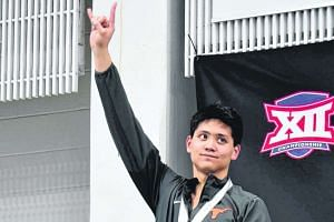 Joseph Schooling clocked 44.06 seconds to win the 100-yard butterfly on Saturday morning (Feb 25).