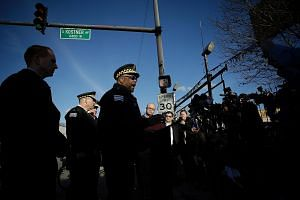 Chicago Police Superintendent Eddie Johnson with reporters at the scene of a triple shooting in the North Lawndale neighbourhood on Feb 14. Consultant and urban demographics expert Rob Paral said there have been many killings inChicago,but the ra