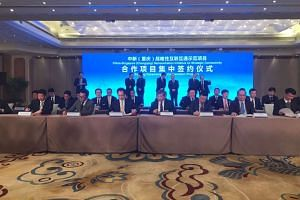 Minister in the Prime Minister's Office Chan Chun Sing and Chongqing Mayor Zhang Guoqing witnessed the signing ceremony of 10 commercial deals worth about US$1.4 billion (S$1.97billion) at China World on Sunday (Feb 26).