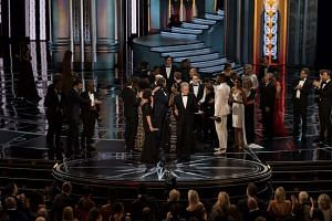 Warren Beatty presents the Oscar for Best Motion Picture Of The Year to the cast and crew of Moonlight during the 89th annual Academy Awards ceremony at the Dolby Theatre in Hollywood, on Feb 26, 2017.