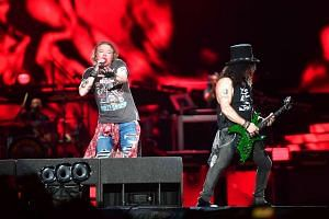 Guns N' Roses' frontman Axl Rose and guitarist Slash performing at the Changi Exhibition Centre on 25 Feb, 2017.