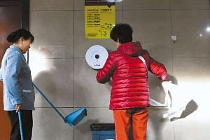 People in Beijing have been caught on camera raiding public toilets for the toilet paper.