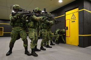 NS men in action at the SAF Multi-Mission Range Complex - a first of its kind three-storey indoor live firing range located at Pasir Laba.