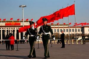 Chinese People's Liberation Army soldiers patrolling the Tiananmen Square beside the Great Hall of the People where a press conference for the 5th session of the 12th Chinese People's Political Consultative Conference (CPPCC) National Committee will