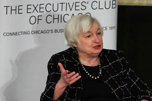 """Federal Reserve Chair Janet Yellen told a Chicago business group that lifting benchmark interest rates """"would likely be appropriate"""" if employment and inflation trends stay solid."""