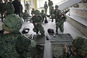 Recruits undergoing weapon- handling practice at the SAF Basic Military Training Centre on Pulau Tekong. In all, more than 96 per cent of full-time national servicemen who enlist from this January will receive the Workforce Skills Qualification annua