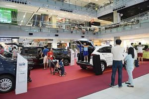 A Venture Cars roadshow at OneKM mall in Katong. The dealership's director says hybrids now make up 60 per cent of its sales.