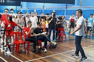 Producer Lee Chong Hoon (seated, left) and director Teng Bee assessing an aspiring actor during the audition at the Permata Sports Complex in Paya Terubong.