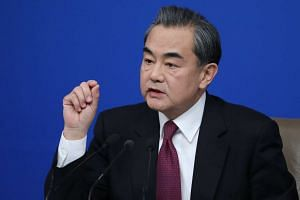 Chinese Foreign Minister Wang Yi gestures as he answers a question during a press conference on the sidelines of the fifth session of the 12th National People's Congress (NPC) in Beijing, China on March 8, 2017.
