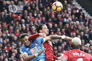 Manchester United's Swedish striker Zlatan Ibrahimovic elbowing Bournemouth's English defender Tyrone Mings during Saturday's game at Old Trafford in Manchester, north west England.