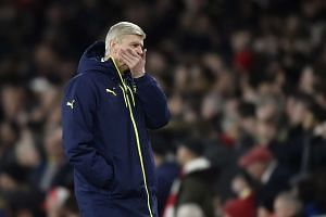 Arsenal manager Arsene Wenger reacts during their Uefa Champions League round of 16 second leg football match against Bayern Munich.