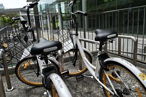 A bicycle from bicycle sharing company Obike, at a rental park next to an MRT train station in Singapore.