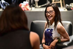 Actress Michelle Yeoh receiving the Singapore International Film Festival's first Cinema Legend Award.
