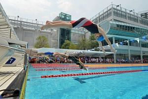 Swimmers from the 12-and-under girls' category diving off the blocks in the 100m freestyle heats at the inaugural Chinese Swimming Club (CSC) Super Junior Swimming Invitational, on Sept 4, 2016. News that the Singapore Swimming Association (SSA) is