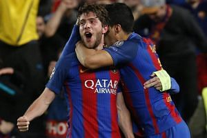 Barcelona's Sergi Roberto (left) celebrates after scoring a goal during the Uefa Champions League round of 16 second leg football match between Barcelona and Paris Saint-Germain.