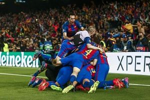 Barcelona's players celebrate their 6-1 win during the Uefa Champions League second leg round of 16 match against Paris Saint-Germain.