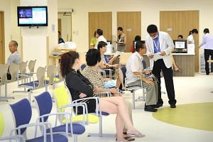 Visitors waiting at the Acute Care and Emergency (A&E) centre of Khoo Teck Puat Hospital.