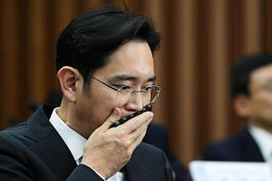 Lee Jae Yong wipes his mouth with a handkerchief during a parliamentary hearing at the National Assembly in Seoul.