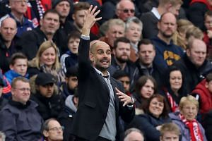 Guardiola gestures on the touchline during the match.