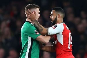 Lincoln's Jonathan Jack Muldoon and Arsenal's Theo Walcott at the end of the match.