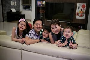 Ms Evelyn Goh and her husband Eddy Cheong with their children - Elyse, nine, Emmanuel (centre), seven, and Ebenezer, three. The couple work in the financial advisory sector and anticipate a fixed retirement income of $4,800 a month, to be supplemente