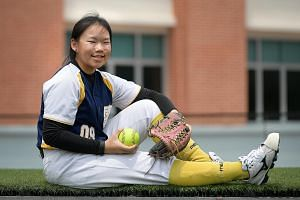Softball player Sydney Tan was accepted by Nanyang Girls' High School under the Direct School Admission scheme, even though her PSLE T-score of 249 was below the school's usual cut-off.