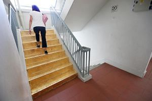The gold-foiled staircase at a Housing Board block in Jalan Rajah by art student Priyageetha Dia.