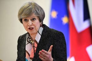 British Prime Minister Theresa May  holds a press conference during a European Summit at the EU headquarters in Brussels on March 9, 2017.