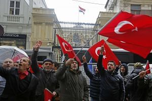 Supporters of Turkish President Recep Tayyip Erdogan shout slogans against the Netherlands in front of the Dutch Consulate in Istanbul, on March 12, 2017.