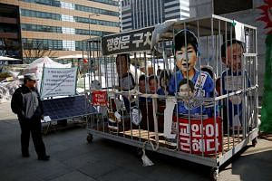 A cutout of ousted leader Park Geun Hye is displayed inside a mock jail in Seoul, South Korea, on March 13, 2017.