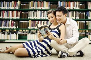 Mr Wu Weiquan and Ms Constance Ho, in a snapshot taken in 2013 during their wedding photo shoot at the NUS central library.