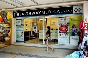 Checks by The Straits Times showed that no doctors turned up for work at seven of Healthway's family clinics yesterday, including this one in Tampines Street 21. Healthway Medical Corp is facing a liquidity crunch.
