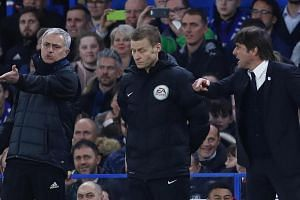 Manchester United manager Jose Mourinho and Chelsea manager Antonio Conte clash as the fourth official Mike Jones looks on.